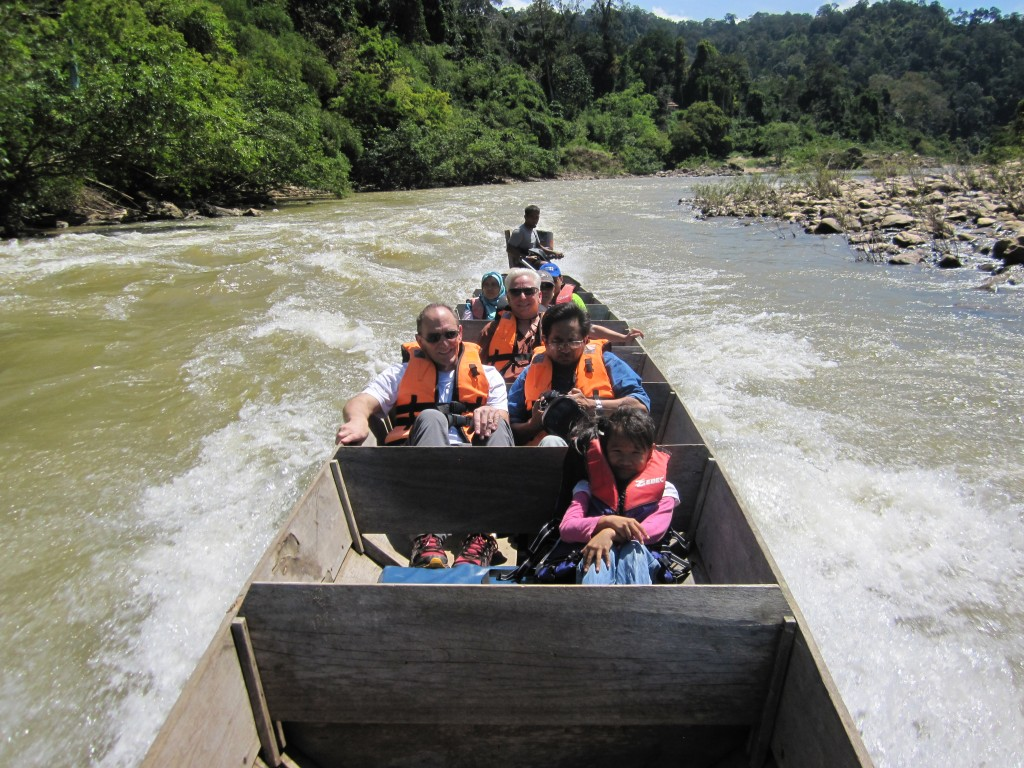 Running the river rapids on our way back to the pier at the Tman Negara Rainforest Entry.